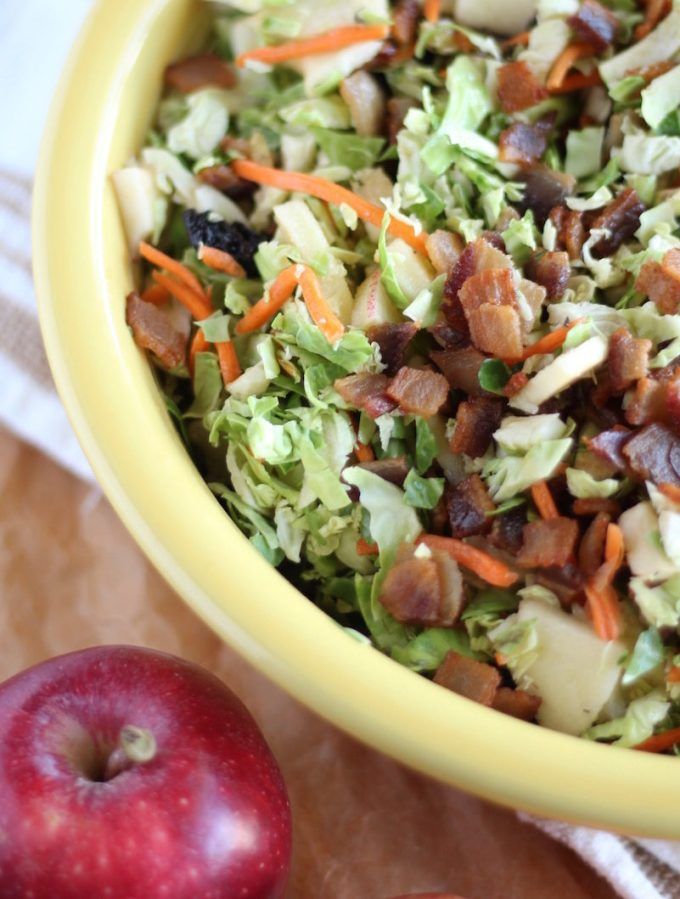 Apple Bacon Brussels Sprouts Salad - this Paleo and AIP-friendly salad is perfect for Fall! Complete with crispy bacon, dried cherries, fresh apples, carrots, and an apple cider vinaigrette! | fedandfulfilled.com