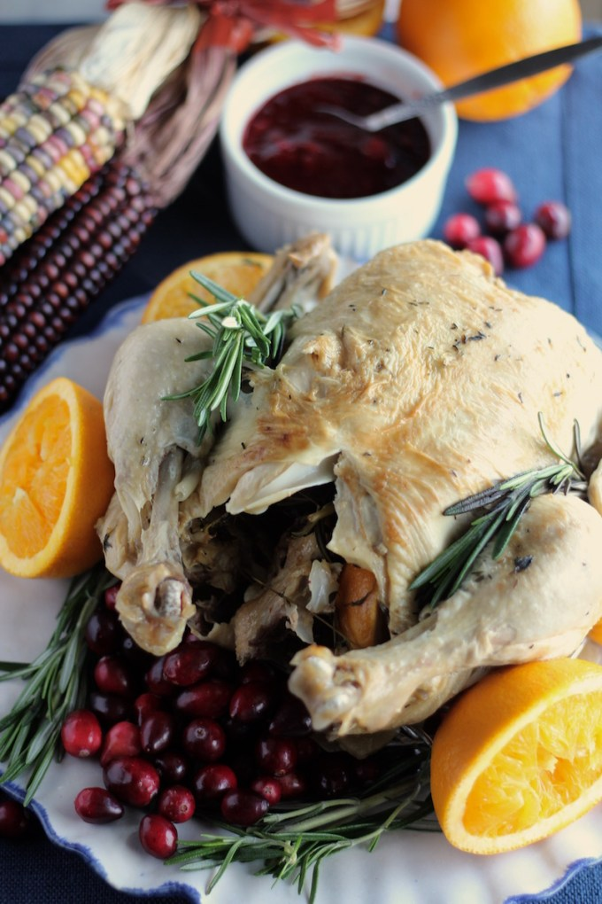 Instant Pot Whole Chicken with Cranberry Orange Sauce (AIP) - this chicken cooks in less than an hour, thanks to the Instant Pot! Served with a delicious sauce made with fresh cranberries, oranges, and balsamic! | fedandfulfilled.com