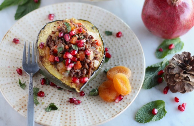 Paleo Moroccan Lamb Stuffed Squash (AIP) - this sweet and savory main dish meal features roasted squash stuffed with lamb, veggies, dried fruit, fresh mint, and pomegranate seeds for a taste of Morocco! | fedandfulfilled.com