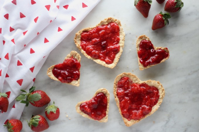 Paleo Strawberries and Cream Tart (AIP, Vegan) - a stunning dessert for a special occasion! Featuring fresh strawberry and coconut cream filling and an easy coconut cookie crust! | fedandfulfilled.com