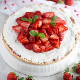 Paleo Strawberries and Cream Tart (AIP) - a stunning grain-free fresh strawberry tart, with juicy berries, dairy-free coconut cream, and a coconut cookie crust! YUM! | fedandfulfilled.com