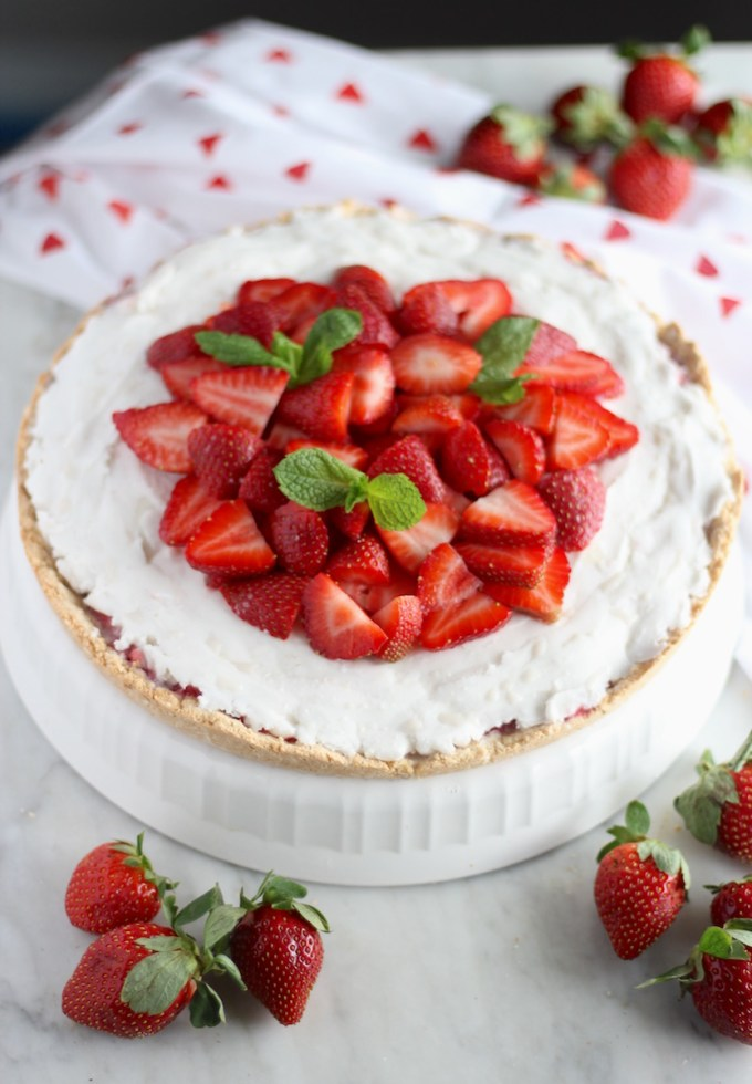 Paleo Strawberries and Cream Tart (AIP, Vegan) - a stunning grain-free fresh strawberry tart, with juicy berries, dairy-free coconut cream, and a coconut cookie crust! YUM! | fedandfulfilled.com