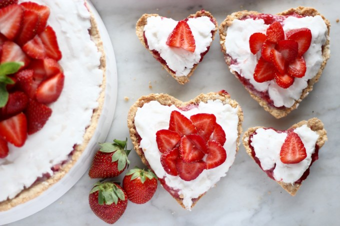 Paleo Strawberries and Cream Tart (AIP, Vegan) - a beautiful fresh strawberry dessert featuring juicy berries, a sweet dairy-free coconut filling, and a crispy coconut cookie crust! | fedandfulfilled.com