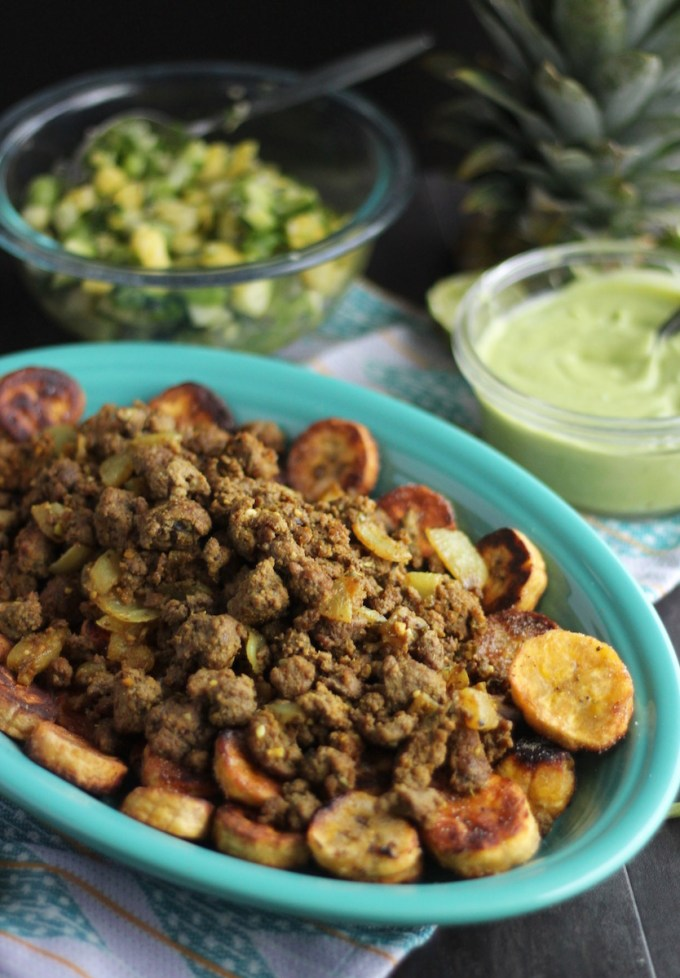 Loaded Tropical Plantain Nachos (AIP, Paleo) - a delicious, nightshade-free nacho recipe featuring fried plantains, pineapple salsa, avocado lime sauce, and BACON! | fedandfulfilled.com