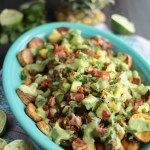 Loaded Tropical Plantain Nachos (AIP, Paleo) - these fried plantain nachos are topped with grassfed beef, pineapple kiwi salsa, avocado lime crema, and of course, BACON! | fedandfulfilled.com