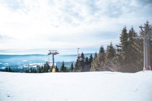 Snow covered ski resort with chairlift.