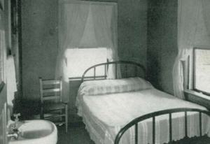 An inside glimpse of one of the 60 bedrooms of the remodeled 1935 Hotel Bame shows two large windows with the bed in between. One can just imagine the sounds of the rolling surf and cool breezes. Guests had a lavatory for convenience since the bathroom was down the hall.