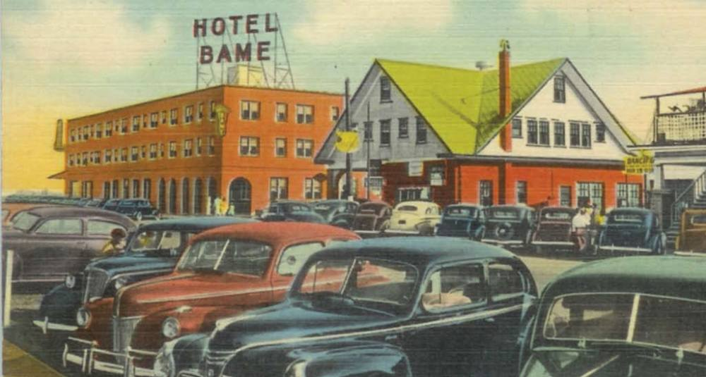 "This postcard shows the Hotel Bame, rebuilt in 1941, with the Bame Esso Service Station and Grocery next door. The station and grocery was run by J. C. ""Mike"" Bame. It started as just a station, later they added the grocery store and a second story with rooms to rent. Eventually another two story building was added to the back that housed apartments. This building still stands on Cape Fear Blvd. and was most recently used as the Sterling Craft Mall."