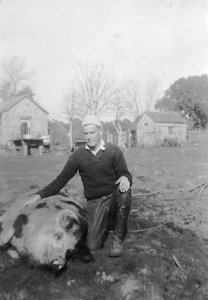 "Dad and his pet pig ""Poli"" Dec. 26, 1932"