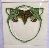 Grape vine and ivy original design fireplace tiles, cream background, some chips $160 for both panels