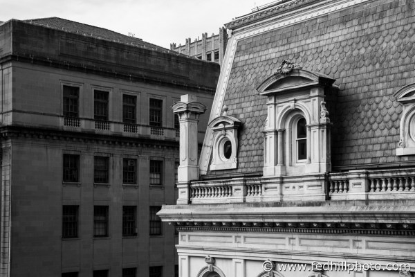 Black and white fine art photo of City Hall and Courthouse East, or Old Postal Service Building, in Baltimore, Maryland.
