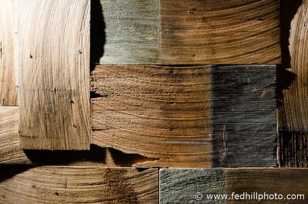 Fine art photo of an arrangement of interlocking multi-color cedar wood shake shingles.