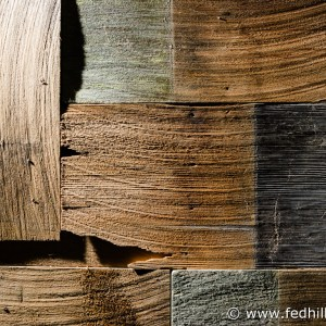 Fine art photo of an arrangement of interlocking multi-color cedar wood shake shingles.