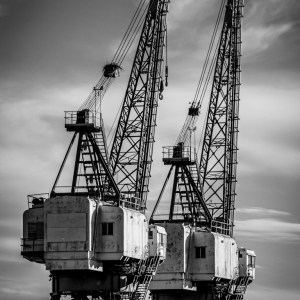 Black and white fine art photo of industrial ship cranes in Locust Point, Baltimore, Maryland.