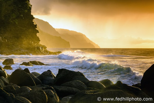 Fine art photograph of sunset over Pacific Ocean surf, water, and waves at Napali Coast Ke'e beach and cliffs, Kauai, Hawaii.