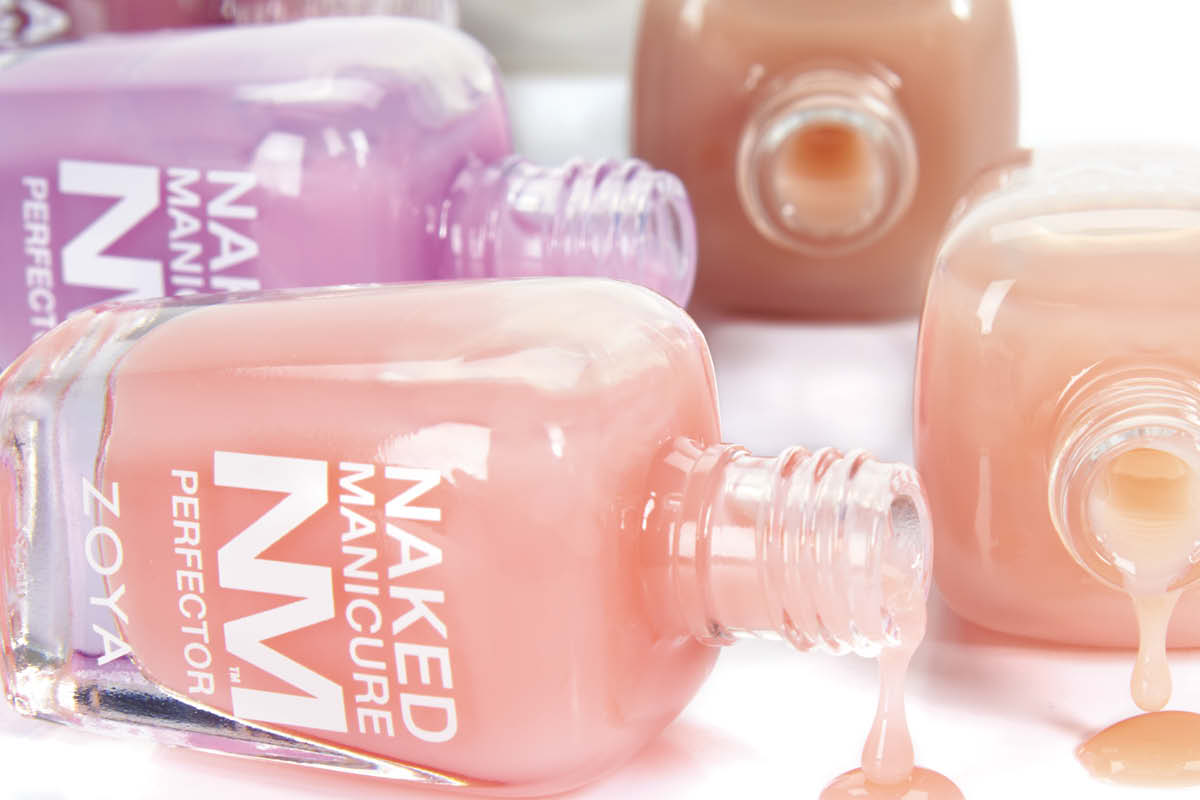 The Naked Manicure Perfectors are scattered on a white surface in a zoomed-in spill picture.