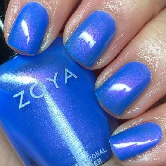 A hand showing Saint by Zoya worn on the fingernails.