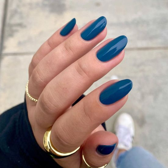 A hand showing Lou by Zoya worn on the fingernails.