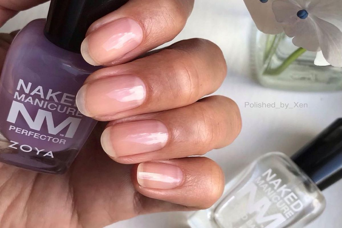 A natural manicure is shown, using the ZOYA Lavender Perfector and Naked Base.