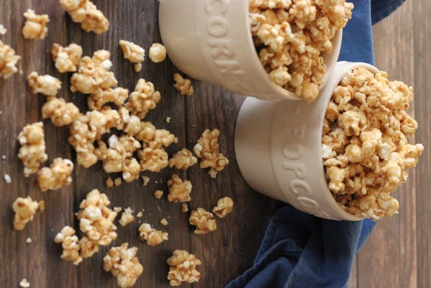 Homemade Caramel Popcorn is a simple and super tasty treat!! This recipe makes a crunchy popcorn that won't pull out your teeth!