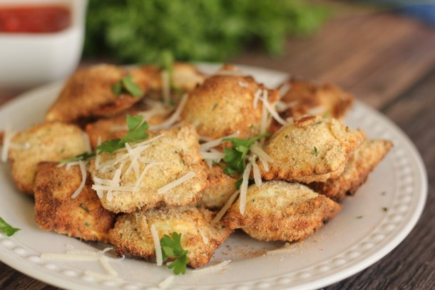Air fried Raviolis are covered in a golden, crunchy crust. Served perfectly with a bowl of marinara for dipping.