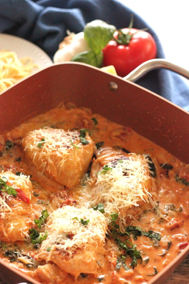 chicken thighs in a creamy tomato spinach sauce