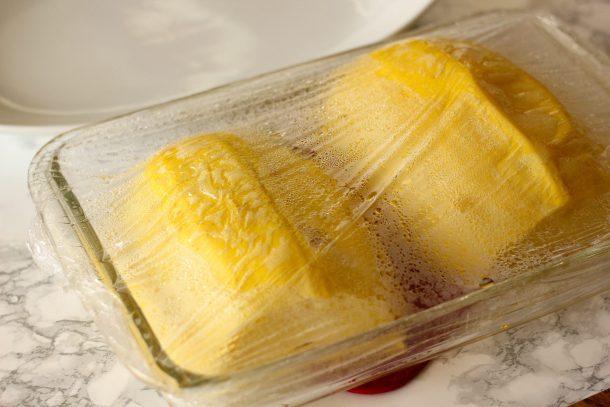 microwaved spaghetti squash in a glass baking dish