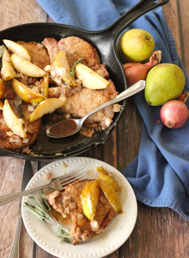 Pan Seared Pork Chops with Pears and shallots in a cast iron pan