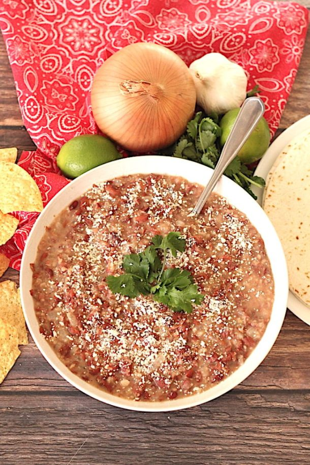 simple refried beans topped with cilantro and queso cotijo