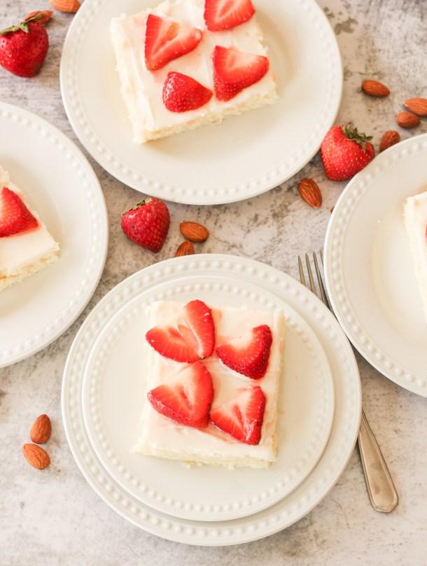 slices of texas sheet cake on white plates