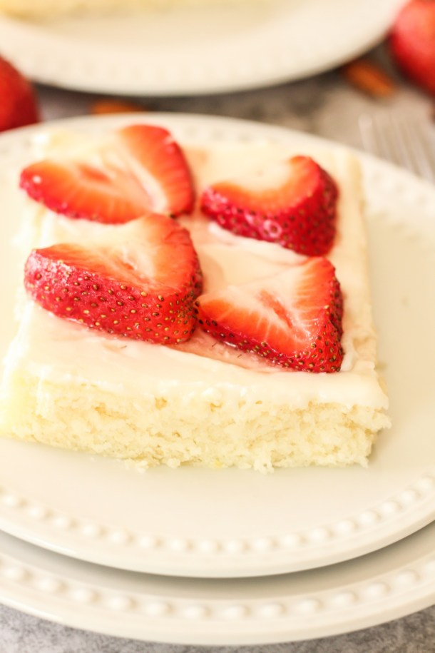 white texas sheet cake topped with strawberries