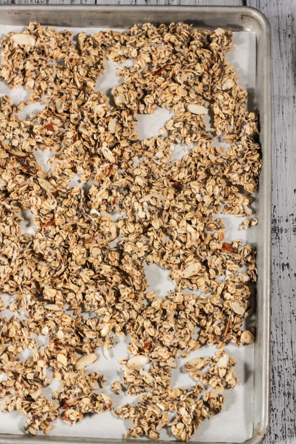 uncooked granola on a baking sheet
