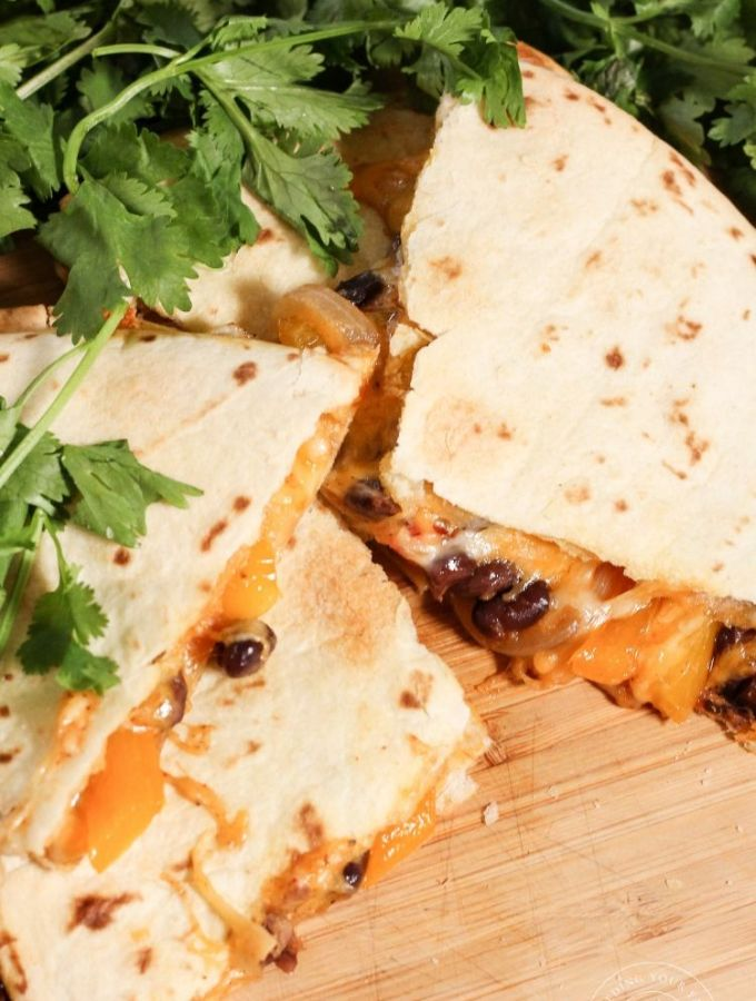 vegetable black bean quesadillas on a wooden platter