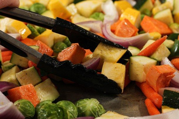 tossing roasted vegetables