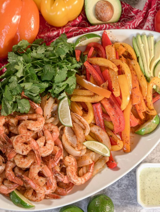 plate with shrimp, peppers and onions