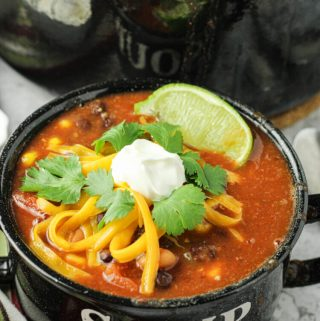 soup topped with sour cream and cheese