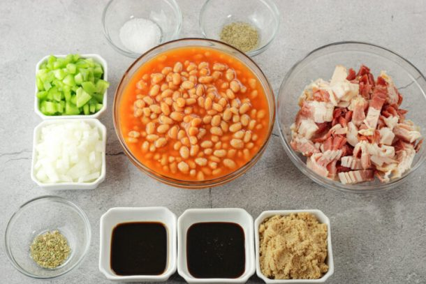 ingredients for baked beans in little bowls. Beans, bacon, brown sugar, green peppers, onions, salt and pepper. Oregano, molasses, Worcestershire, brown sugar