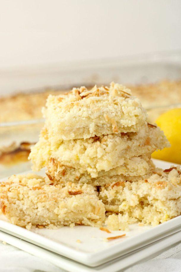 pile of creamy lemon bars on a white plate