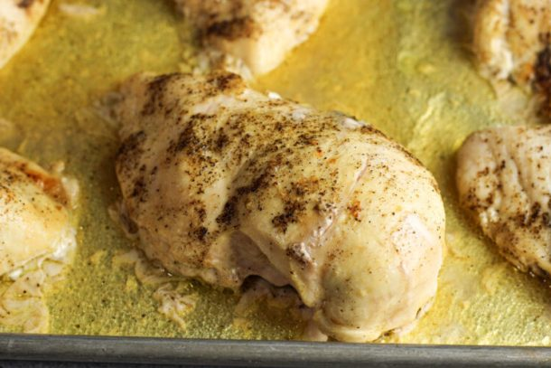 cooked chicken breast seasoned with salt and pepper