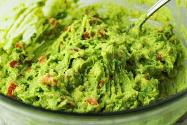 guacamole in a glass bowl