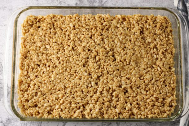 peanut butter rice krispies pressed into a pan