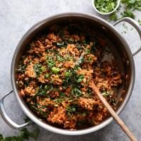 jambalaya with greens in a pot