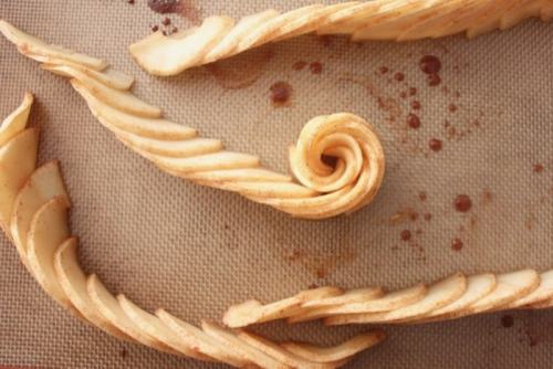 curl the row of baked apple slices to start forming apple rose
