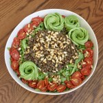 arugula lentil salad with cumin toasted pine nuts, oven roasted tomatoes and avocado