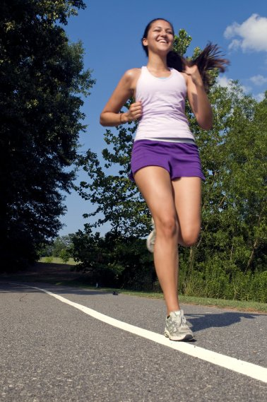 15255-a-young-woman-jogging-outdoors-pv