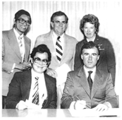 Five people at a document signing, three standing in back. Two seated in front are miriam Lee and Governor Jerry Brown