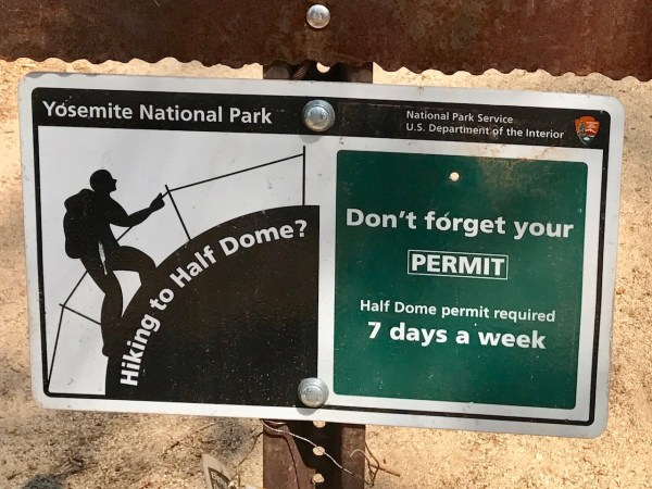 Sign reminding hikers to bring their permits.
