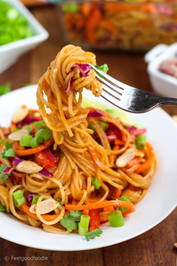 A bright and colorful Spicy Asian Noodle Salad filled with fresh vegetables and tossed in a creamy nutty dressing - it's vegan, light and delicious!