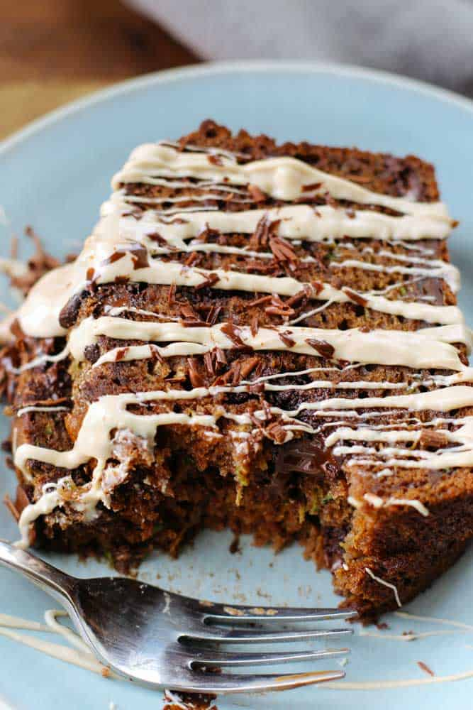 This Chocolate Chip Zucchini Bread is a moist and cake-like bread that sneaks in a cup and half of vegetables into dessert - no one will even know!