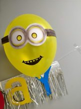 . I used Canva to design a birthday Minion Image, and got it printed on edible paper to top off the cake.